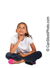 little indian girl daydreaming - young indian girl sitting...