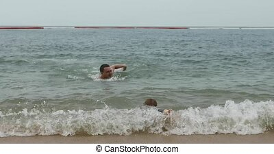 Little infant running with man on sea