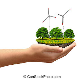 Little island with wind turbines and trees in the hands