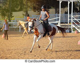 Little jockey and horse - A little girl getting a horseback ...