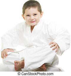 Little karate kid legs crossed - Little karate kid sitting...