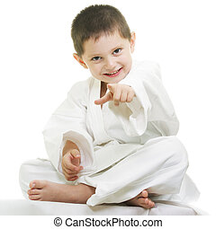 Little karate kid pointing forward