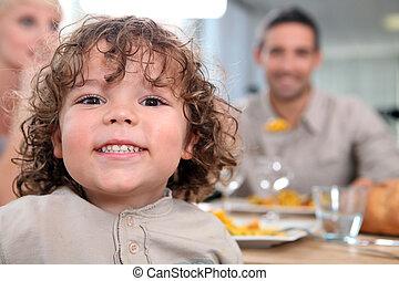 Little kid at kitchen table