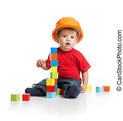 little kid in hard hat with building blocks