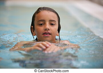 Little kid in swimming pool