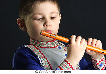 Little kid looking at wooden flute