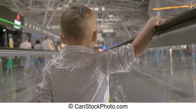 Little kid on flat escalator in trade center