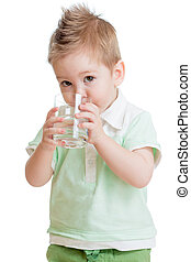 Little kid or child drinking water from glass isolated on...
