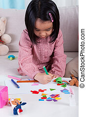 Little kid painting a picture