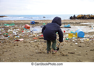 Little kid playing on beach with dirt disaster and danger