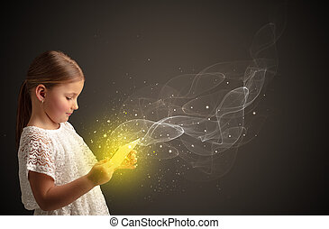 Little kid playing on sparkling tablet