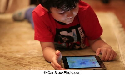little kid using digital tablet 1