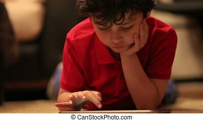 little kid using digital tablet 2