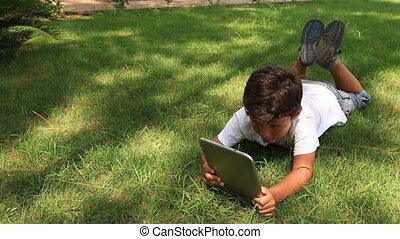 little kid using digital tablet