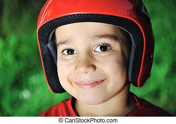 Little kid with biking safety helmet portrait