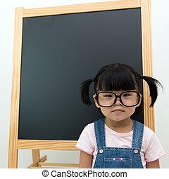 Little kid with blackboard