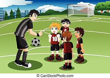 Little kids in soccer field listening to their coach - A...