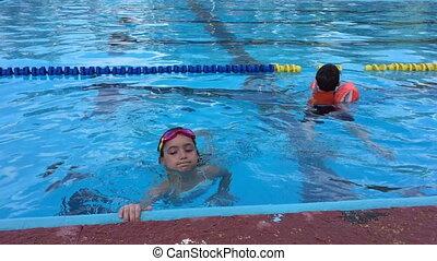 little kids in the pool
