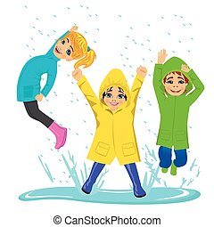 little kids playing on puddle wearing colorful raincoats and boots
