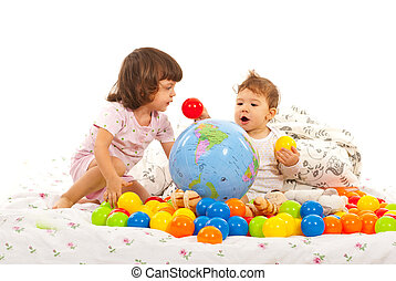 Little kids playing with balls