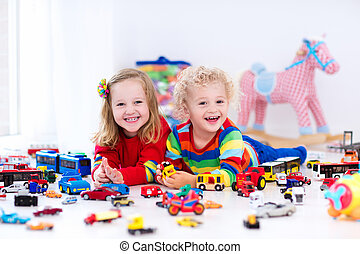 Little kids playing with toy cars - Little toddler boy and ...