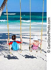 Little kids swinging