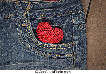 little knit heart in the front pocket of blue jeans