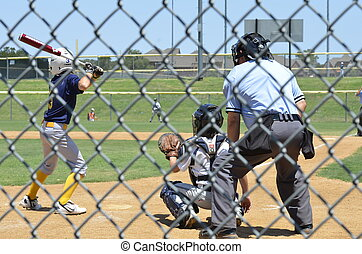 Little League Baseball Game - Batter, Catcher and Umpire as...