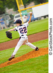 Little league baseball pitcher on the mound.
