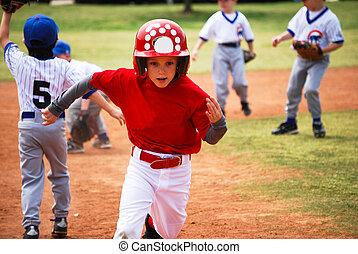 Little league baseball player running bases