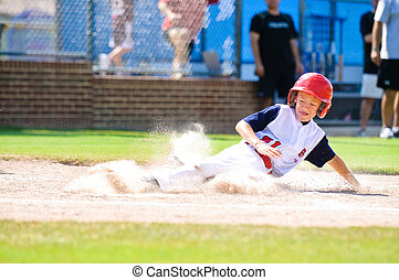 Little league baseball player sliding home. - Youth baseball...