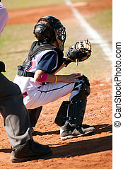 Little league catcher during game