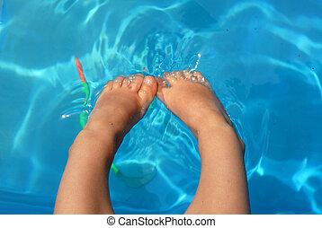 Little legs in the water - little girl\'s legs playing in...