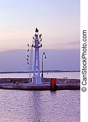 Little lighthouse with seagulls in the evening, Odessa, Ukraine