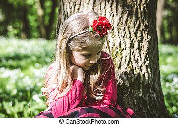 little lovely blond girl in forest