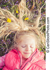 little lovely child lying in the meadow