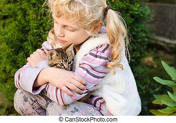 child with cat