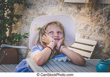 little lovely girl in hat portrait