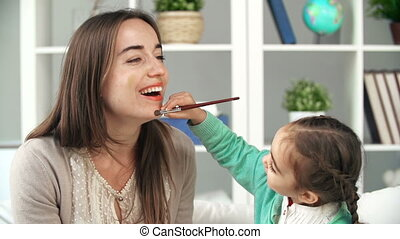 Little Make Up Artist - Little girl painting on her mother%...