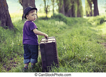 Little cute man leaving home with huge luggage