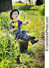 Little man with bouquet of flowers