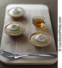 little maple syrup tart - mini maple syrup tart on a wooden...