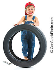 Little mechanic with a tire