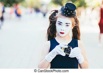 little mime girl shoots video on cameras