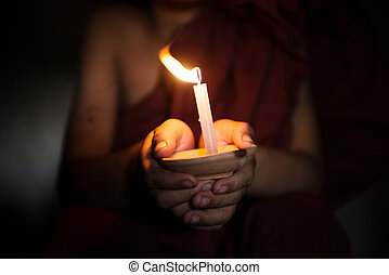 Little monk blessing - Little monk holding a candlelight