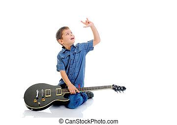Little musician playing guitar