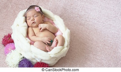 Little newborn baby girl in the Studio