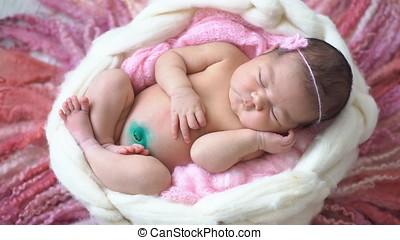 Little newborn baby girl in the Studio.