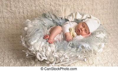 Little Newborn Baby - Little newborn baby girl is lying on...