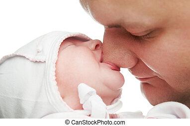 Little newborn baby sucking father nose